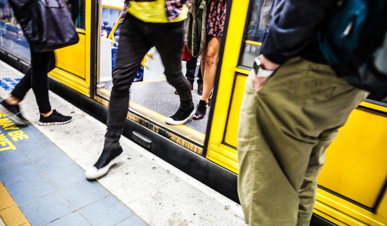 Individual walking off train