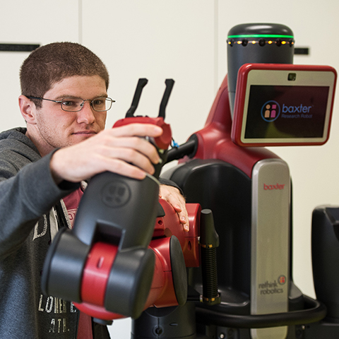 Student with Baxter the robot