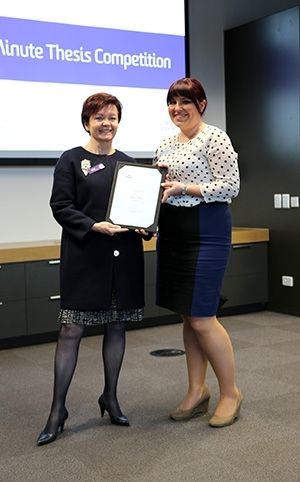 Deakin University Vice-Chancellor Professor Jane den Hollander and 3MT winner Ms Natalie Gasz.