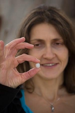 Dr Mylene Mariette with a zebra finch egg.