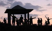 students at sunset at a gazebo