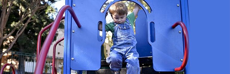 a child on playground equipment