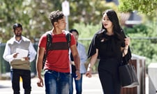 students talking while walking together