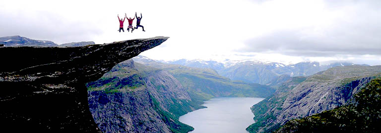 Deakin study abroad students atop a fjord cliff in Sweden