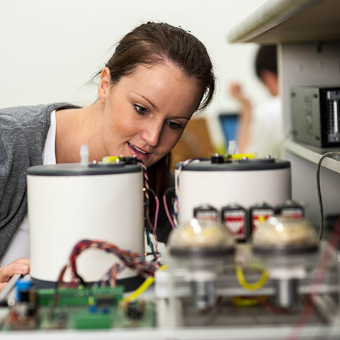 Female student with electrical equipment