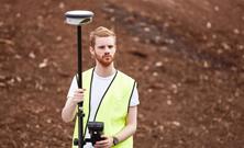 male measuring in the field