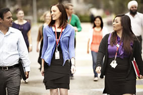 Staff walking on campus