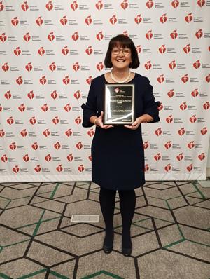Professor Andrea Driscoll receiving a prestigious American Heart Association award.