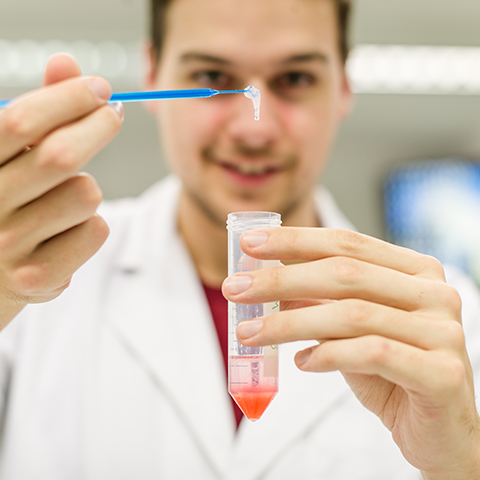 Student holding up a sample from a DNA practical class