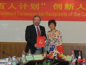 Professor Peter Hodgson (left) and Vice-President of WUST, Gu Jie.