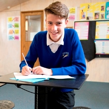 Student Angus Price working on the Sit Stand desks during the Up and Learn study at Thornbury High School.