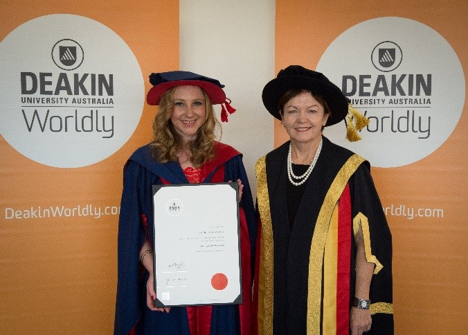 HDR student Rachel Carter accepts her PhD with Professor Jane den Hollander AO, Vice-Chancellor
