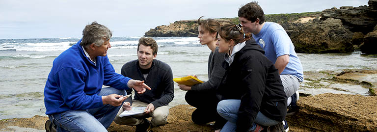 Marine biology lecturer instructs Deakin students at the shore.