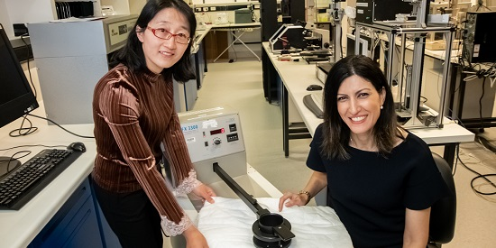 (L-R) Assoc Research Fellow Dr Zengxiao Cai and Dr Maryam Naebe in the Deakin IFM labs with their wool insulator material.