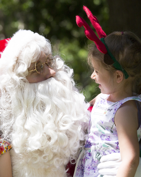 Santa listens to a guest's wish list