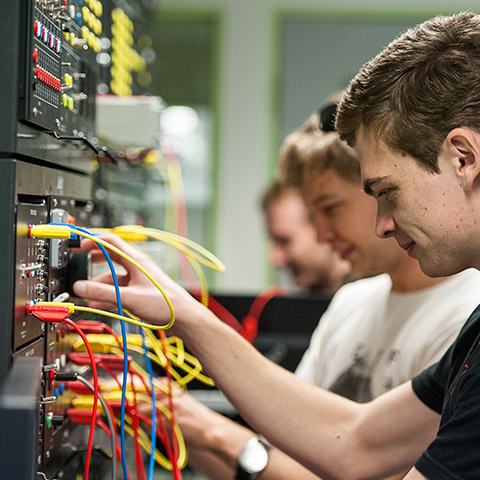 Students with electrical board