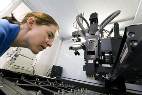 Image of a female looking at laboratory equipment