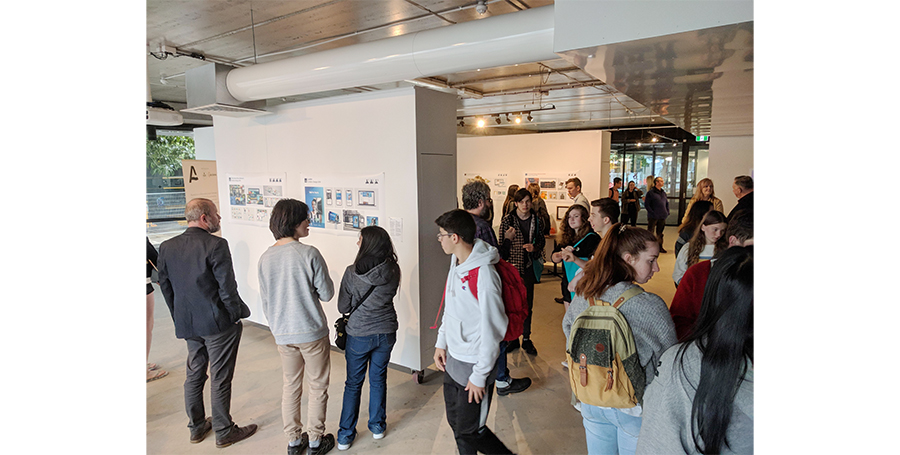 Visitors at the exhibition showcasing student assessments from 2019