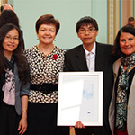 Deakin's Vice Chancellor Prof Jane den Hollander (second from left) with Research Engagement recipient Associate Professor Dinh Phung and International Research Director, Prof Tes Toop.